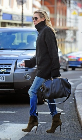 How to wear: black leather duffle bag, olive suede ankle boots, blue skinny jeans, black oversized sweater