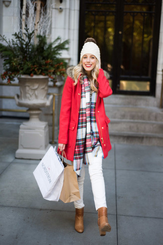 How to wear: white beanie, tan leather ankle boots, white skinny jeans, red parka