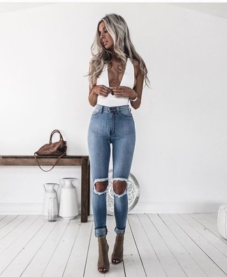 How to wear: brown suede crossbody bag, olive cutout leather ankle boots, light blue ripped skinny jeans, white sleeveless top