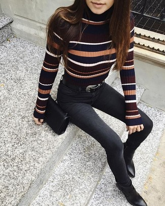 How to wear: black leather crossbody bag, black leather ankle boots, black skinny jeans, multi colored horizontal striped turtleneck