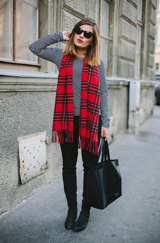 How to wear: black leather tote bag, black leather ankle boots, black skinny pants, black and white horizontal striped long sleeve t-shirt