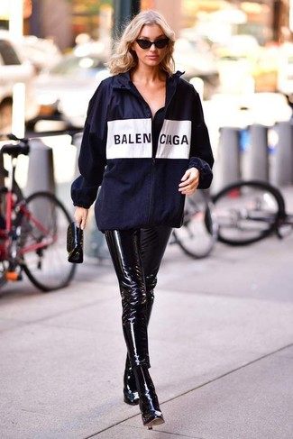 How to wear: black leather clutch, black leather ankle boots, black leather skinny pants, navy print windbreaker