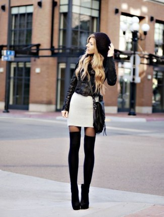 How to wear: black knee high socks, black suede ankle boots, white sweater dress, black leather biker jacket