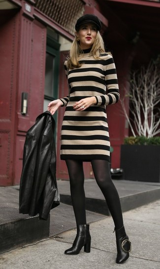 How to wear: black flat cap, black leather ankle boots, tan horizontal striped sweater dress, black leather biker jacket