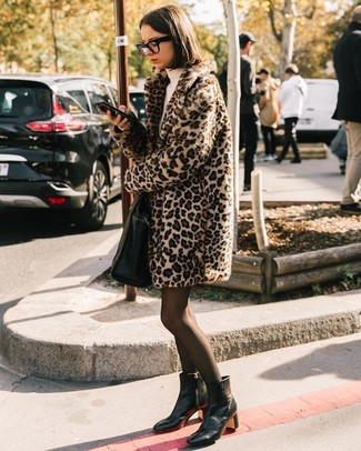 How to Wear Black Tights: Tone down on the formality in this comfy combination of a beige leopard fur coat and black tights. Add an instant sultry vibe to your outfit by rounding off with a pair of black leather ankle boots.