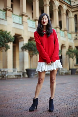 How to wear: black leather crossbody bag, navy suede ankle boots, white polka dot swing dress, red crew-neck sweater