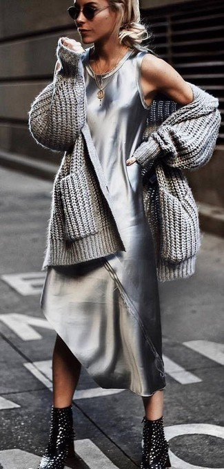 How to wear: black sunglasses, black studded leather ankle boots, silver tank dress, grey knit open cardigan