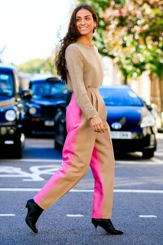 How to wear: gold bracelet, black leather ankle boots, hot pink wide leg pants, tan crew-neck sweater