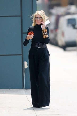 How to wear: black leather waist belt, black leather ankle boots, black wide leg pants, black turtleneck