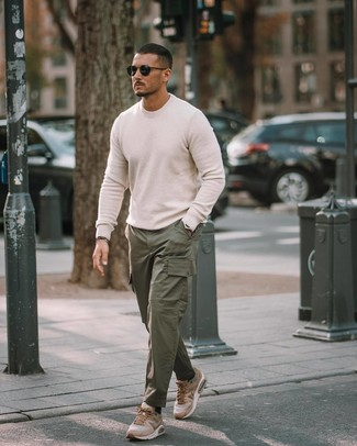 How to wear: black sunglasses, tan athletic shoes, dark green cargo pants, white crew-neck sweater