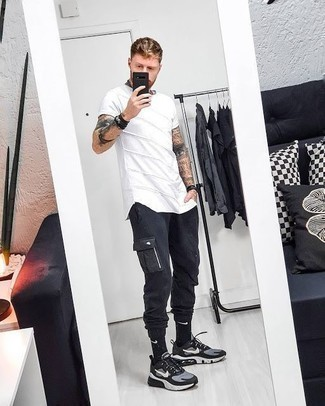 How to Wear Black Cargo Pants: We're all seeking practicality when it comes to styling, and this laid-back combo of a white crew-neck t-shirt and black cargo pants is a practical example of that. To give your overall outfit a more laid-back finish, why not complete this ensemble with black and white athletic shoes?