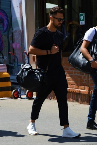 Fashion for 20 Year Old Men: What To Wear: Want to infuse your menswear arsenal with some elegant cool? Opt for a black crew-neck t-shirt and black chinos. Finishing off with white athletic shoes is a guaranteed way to bring a dash of stylish casualness to your outfit.