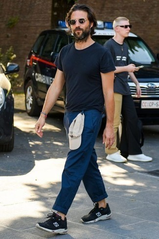 How to Wear a Navy Crew-neck T-shirt For Men: A navy crew-neck t-shirt and navy chinos will infuse your daily repertoire this casually dapper vibe. Black and white athletic shoes can instantly tone down an all-too-polished look.