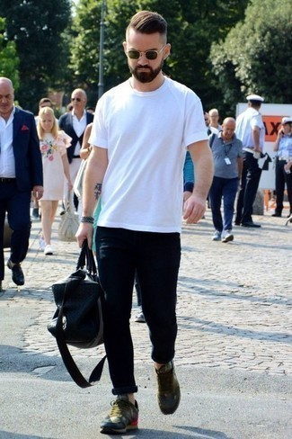 How to Wear a Duffle Bag For Men: We all look for practicality when it comes to styling, and this street style pairing of a white crew-neck t-shirt and a duffle bag is a vivid example of that. Tap into some Idris Elba stylishness and smarten up your outfit with a pair of olive athletic shoes.
