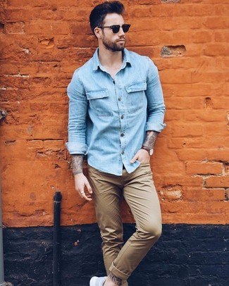 How To Wear a Light Blue Denim Shirt With Light Blue Sneakers For Men: A light blue denim shirt and khaki chinos are the perfect way to inject some cool into your daily casual arsenal. Finishing off with light blue sneakers is the most effective way to add a playful feel to this outfit.