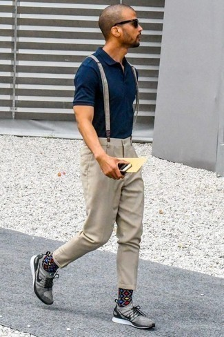 How to Wear a Navy Polo For Men: If you love laid-back pairings, then you'll appreciate this pairing of a navy polo and beige chinos. Rounding off with grey athletic shoes is an effortless way to infuse a dash of stylish effortlessness into this look.