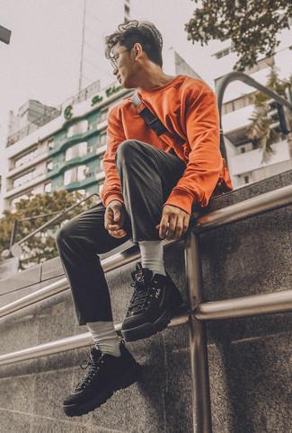 How to wear: orange fanny pack, black athletic shoes, black chinos, orange sweatshirt