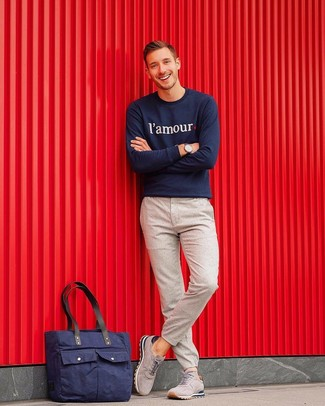 How to wear: navy canvas tote bag, grey suede athletic shoes, beige wool chinos, navy print sweatshirt