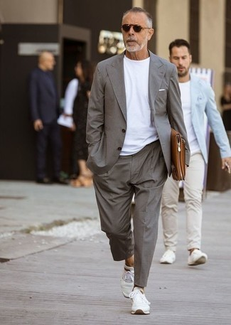 How to Wear White Athletic Shoes For Men: This smart combination of a grey suit and a white crew-neck t-shirt is very easy to pull together in no time, helping you look stylish and ready for anything without spending too much time going through your wardrobe. To infuse a carefree touch into this look, complement this look with white athletic shoes.