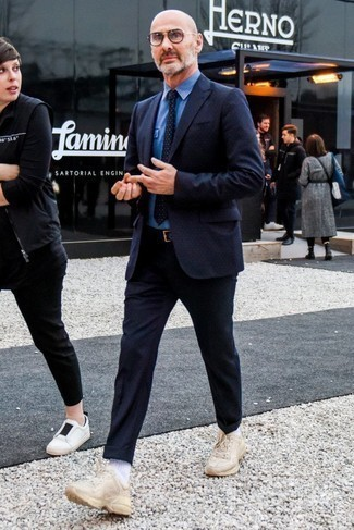 How to Wear a Blue Dress Shirt For Men: Marrying a blue dress shirt with a navy polka dot wool suit is a savvy pick for a stylish and polished outfit. Beige athletic shoes will add a more casual spin to an otherwise mostly classic look.
