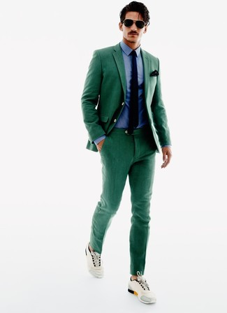 How to wear: navy tie, beige athletic shoes, blue dress shirt, green suit