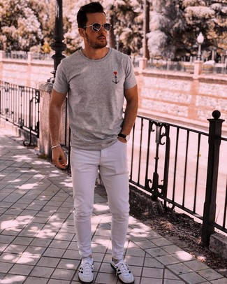 How to wear: charcoal sunglasses, white and black athletic shoes, white jeans, grey print crew-neck t-shirt