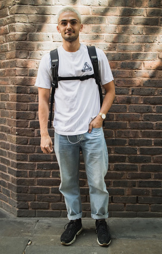 How to Wear a Gold Watch For Men: This off-duty combo of a white and black print crew-neck t-shirt and a gold watch is very versatile and apt for whatever adventure you may find yourself on. Finish off this outfit with black athletic shoes to shake things up.