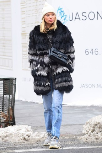 How to wear: black quilted leather satchel bag, grey athletic shoes, light blue jeans, black fur coat
