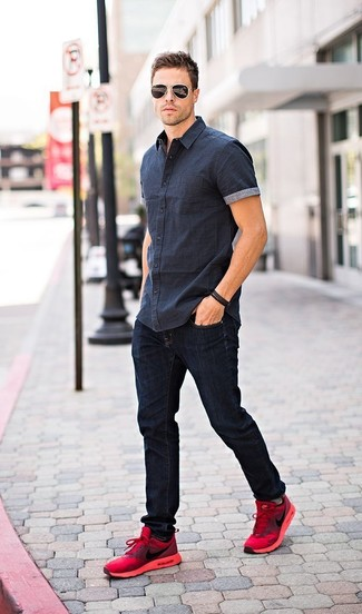 How to wear: black sunglasses, red athletic shoes, navy jeans, navy short sleeve shirt