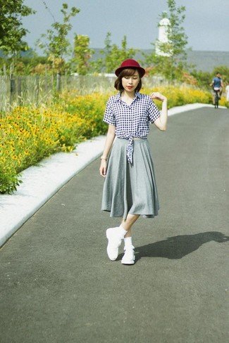 How to wear: burgundy wool hat, white athletic shoes, grey pleated midi skirt, white and black gingham button down blouse
