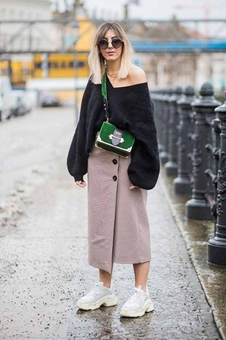 How to wear: green suede crossbody bag, white athletic shoes, beige slit midi skirt, black oversized sweater