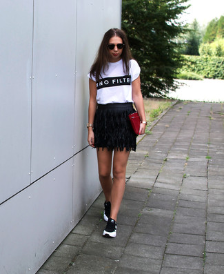How to wear: burgundy leather clutch, black and white athletic shoes, black fringe leather mini skirt, white and black print crew-neck t-shirt