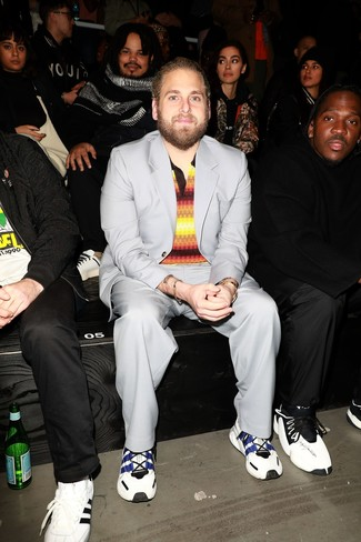 How to wear: gold watch, white and navy athletic shoes, multi colored horizontal striped polo, grey suit