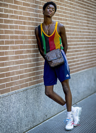 How to wear: dark brown print leather messenger bag, white athletic shoes, blue sports shorts, multi colored mesh tank