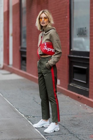 How to wear: red leather fanny pack, white athletic shoes, olive sweatpants, olive hoodie