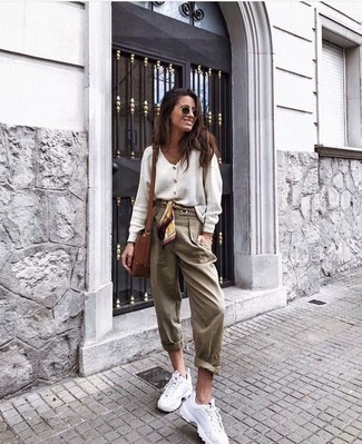 How to Wear Tan Tapered Pants For Women: Go for a pared down yet elegant choice pairing a white cardigan and tan tapered pants. Complete your look with white athletic shoes to keep the look fresh.