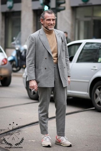 How to Wear a Grey Wool Suit: This polished pairing of a grey wool suit and a tan wool turtleneck will hallmark your outfit coordination chops. Add a pair of beige athletic shoes to the mix to make an all-too-safe outfit feel suddenly fresh.