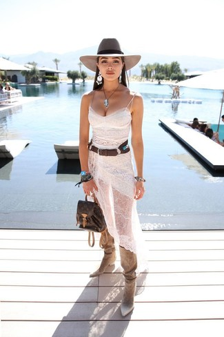 How to wear: grey wool hat, dark brown leather backpack, beige suede knee high boots, white lace cami dress