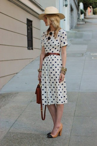 How to wear: dark brown leather belt, dark brown leather backpack, black and tan leather pumps, white polka dot midi dress