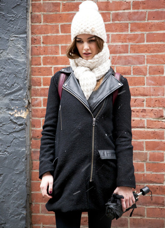 How to wear: white knit beanie, burgundy leather backpack, black skinny jeans, black wool biker jacket