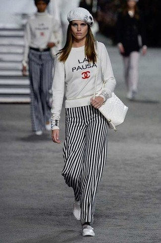 How to wear: white leather crossbody bag, white leather ballerina shoes, white and black vertical striped wide leg pants, white print sweatshirt