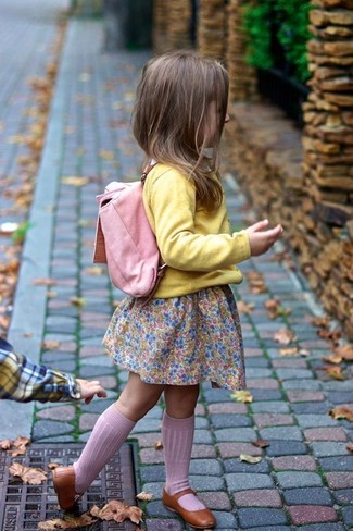 How to wear: pink backpack, brown ballet flats, pink dress, yellow cardigan