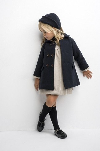 How to Wear Black Socks In Cold Weather For Girls: Choose a charcoal coat and black socks for your kid for a fun day in the park. Black ballet flats are a smart choice to finish this getup.