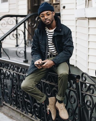 How to wear: black barn jacket, white and black horizontal striped crew-neck t-shirt, olive chinos, beige suede desert boots