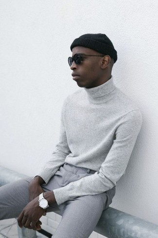 How to wear: black sunglasses, black beanie, grey chinos, grey turtleneck