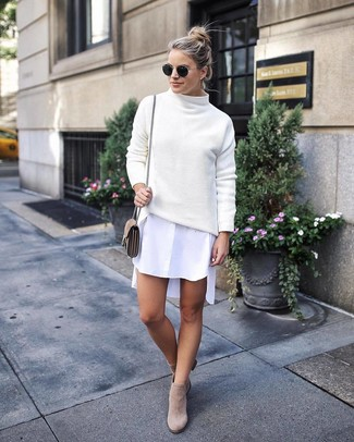 How to wear: beige suede crossbody bag, beige suede ankle boots, white shirtdress, white knit turtleneck