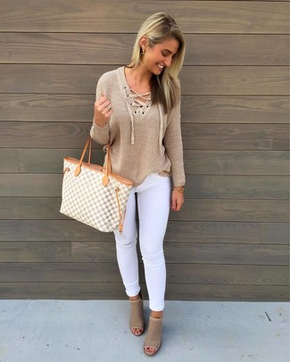 How to wear: grey geometric canvas tote bag, beige cutout leather ankle boots, white ripped skinny jeans, tan v-neck sweater