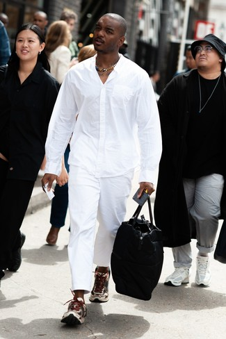 How to wear: black leather holdall, beige athletic shoes, white chinos, white long sleeve shirt