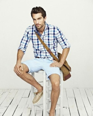 How to wear: tan canvas messenger bag, beige leather boat shoes, light blue shorts, white and blue gingham long sleeve shirt