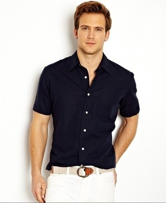 How to wear: beige canvas belt, white shorts, navy short sleeve shirt